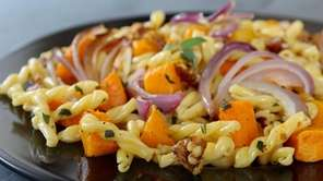 Pasta with roasted red onion, butternut squash, walnuts