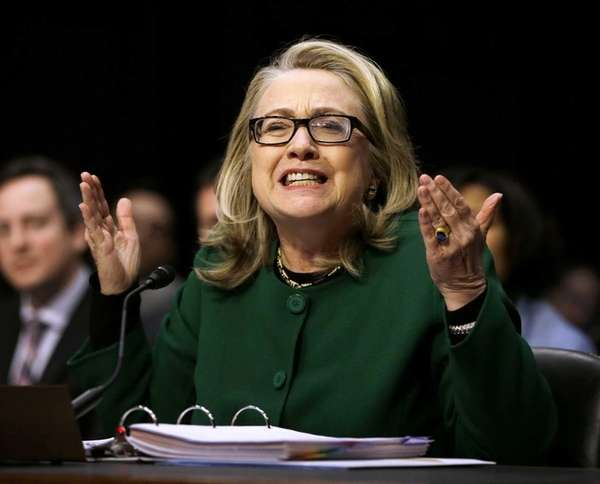 Secretary of State Hillary Rodham Clinton reacts to