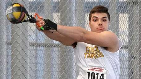 Nick Pisciotta of Commack competes in the weight