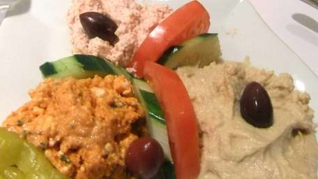 A trio of dips -- taramasalata, hummus and