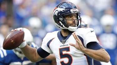 Broncos quarterback Joe Flacco throws a pass during