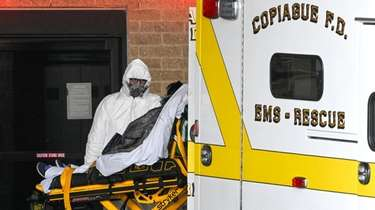 A paramedic in a hazmat suit from the
