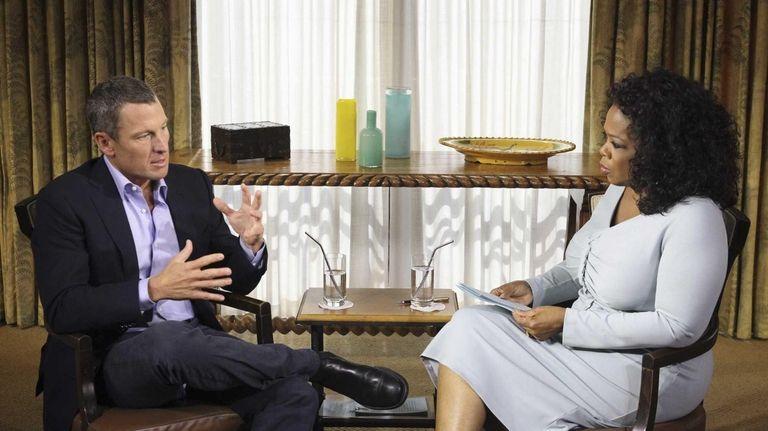 Oprah Winfrey interviews Lance Armstrong during taping for