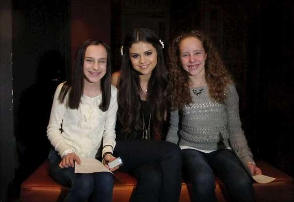 Singer and actress Selena Gomez with Kidsday reporters