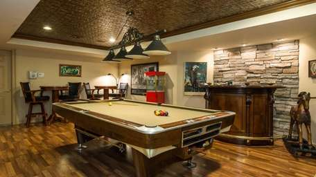 This Roslyn Heights Colonial sports an underground billiard