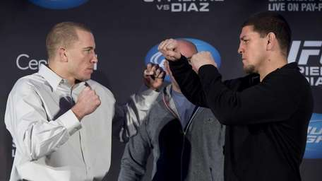 Welterweight UFC champion Georges St-Pierre, left, and Nick