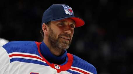 Henrik Lundqvist skates off the ice after a