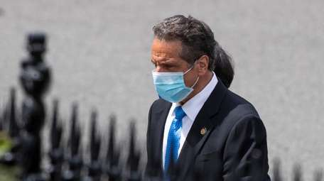 New York Gov. Andrew M. Cuomo walks toward