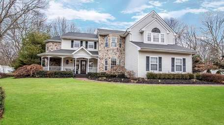 Listed for $879,000, this five-bedroom, 3½-bathroom on a