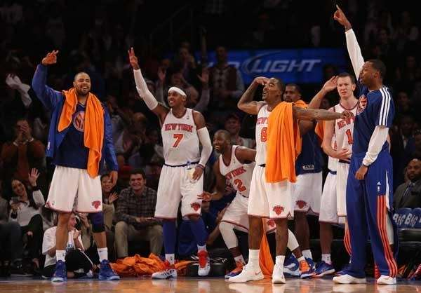 The Knicks' bench celebrates a fourth-quarter three-pointer during