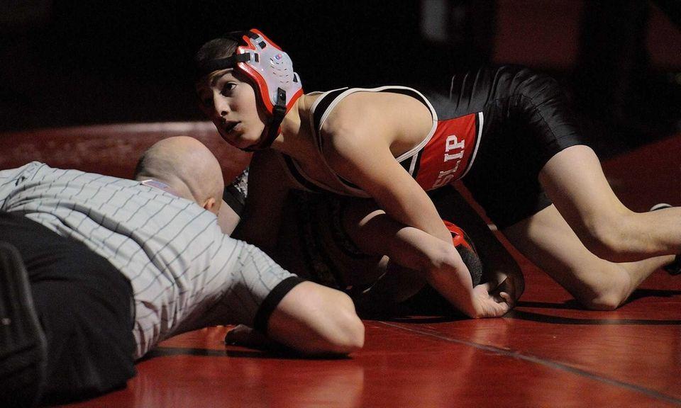 East Islip's Jesse Dellavecchia, top, gets an advantage