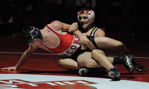 Hills West's Austin Rutella, right, gets a grip