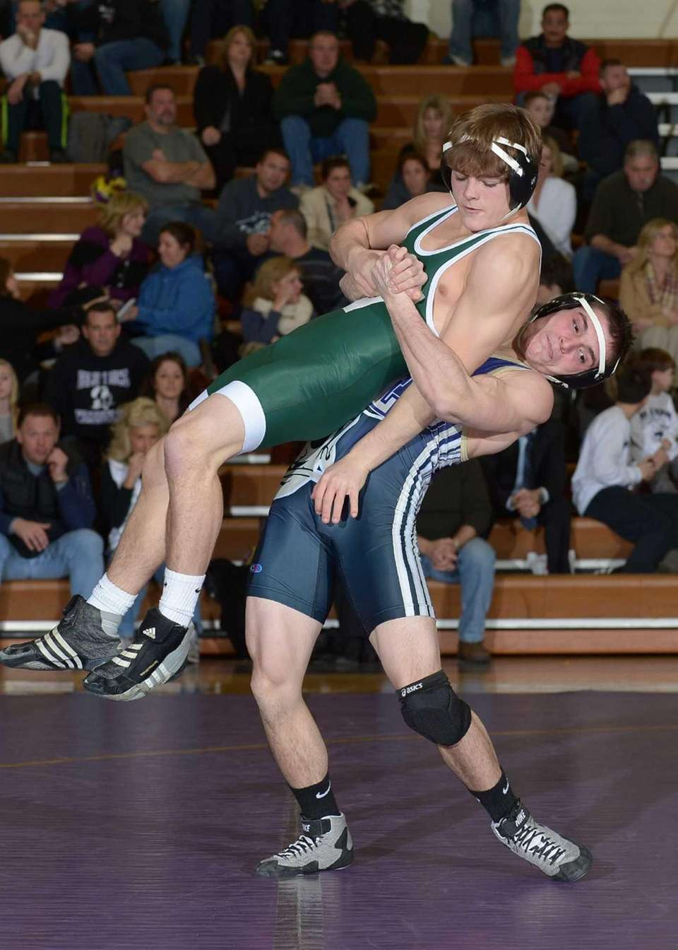 Islip's James Ianaconi lifts Harborfields' Alex Reilly during