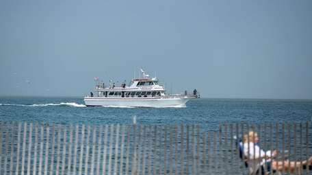 A fishing boat sails out of Captree in