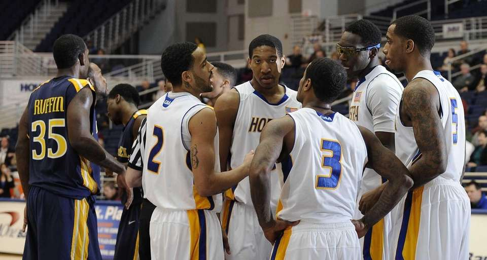 Hofstra teammates gather on the court during the