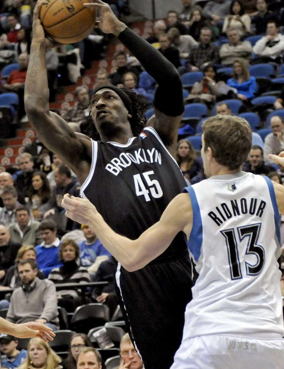 Gerald Wallace, left, shoots as Minnesota Timberwolves guard