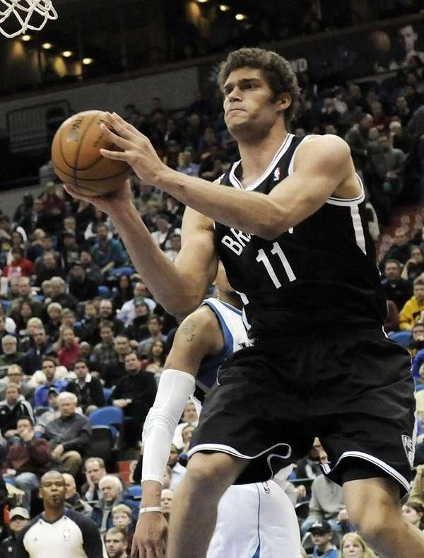 Brook Lopez looks to pass in the second