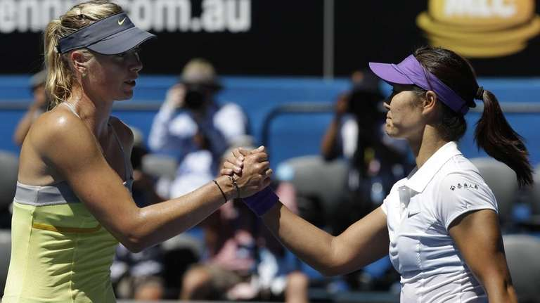 China's Li Na, right, is congratulated by Russia's