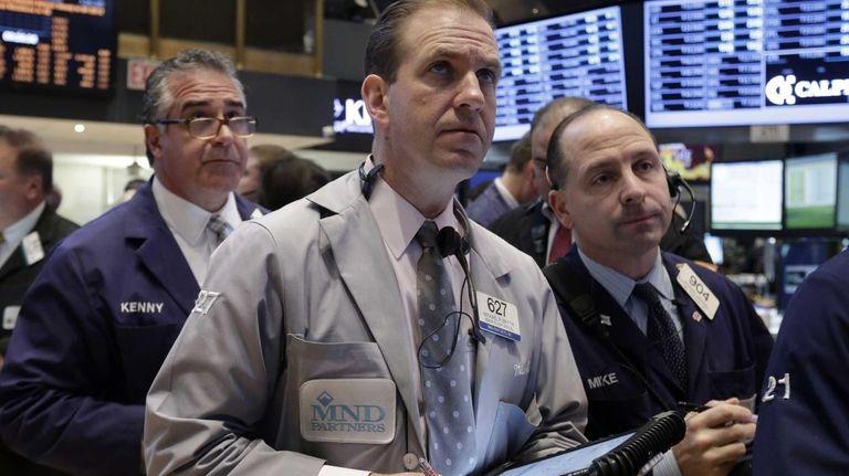 Trader Michael Smyth, center, works on the floor