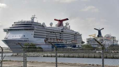 Carnival Cruise ships are docked at the Port