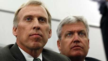 John Idzik, left, sits next to New York