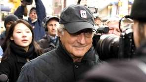 Bernie Madoff walks down Lexington Avenue to his