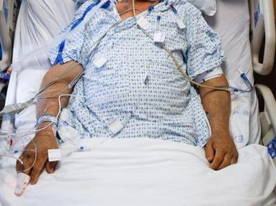 Nurse Antoinnette McPherson adjusts an electrode on a