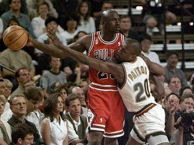 Chicago Bulls guard Michael Jordan holds the ball