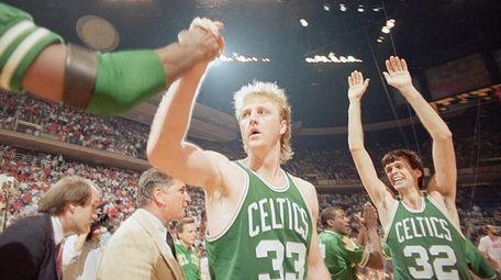 Larry Bird gets a congratulations as Celtics teammate