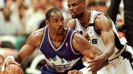 Utah Jazz's Karl Malone, left, moves to the