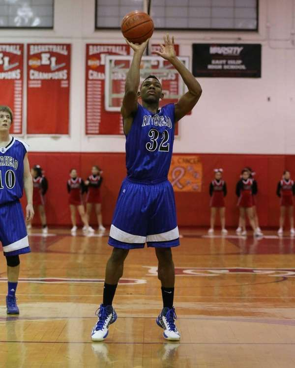 Riverhead's Brandon Tolliver shoots a foul shot during