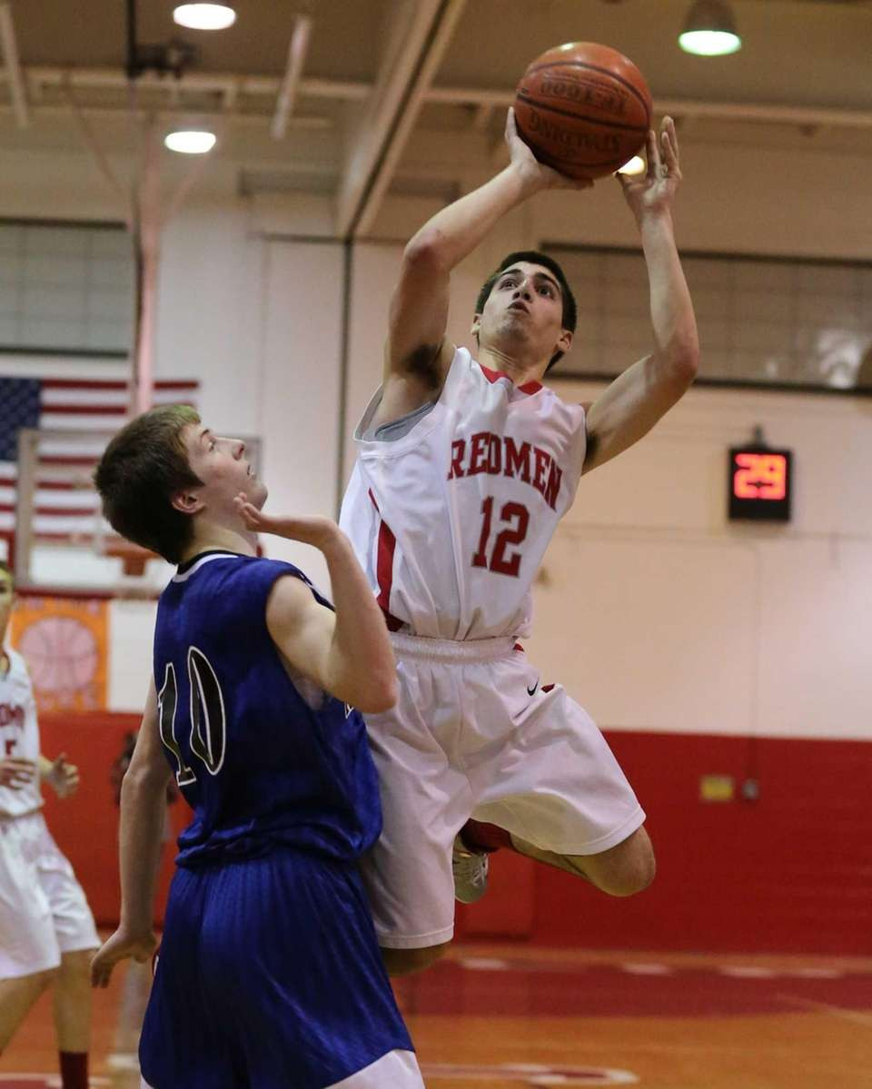 East Islip's Mike Simonetti #12 goes up for