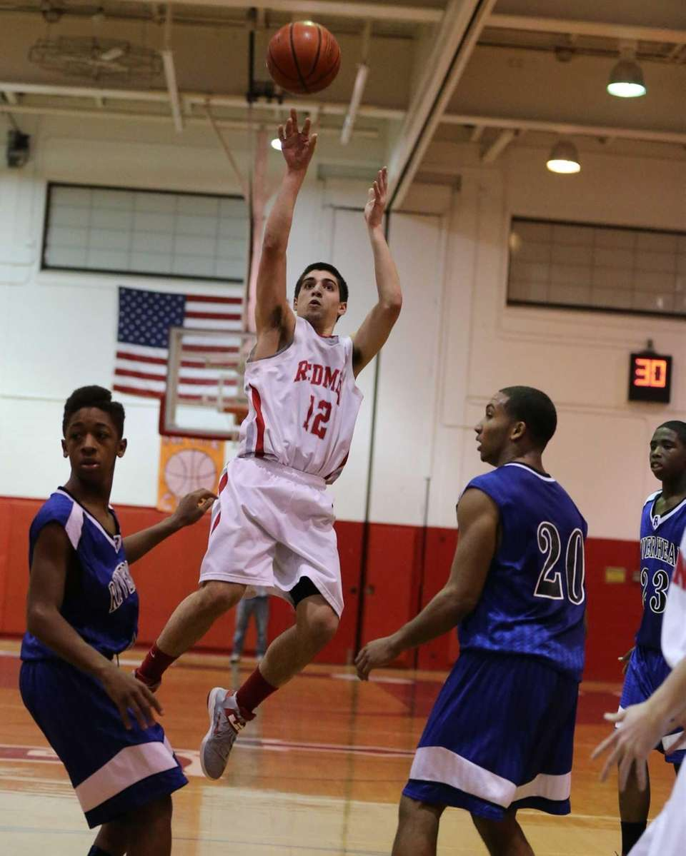 East Islip's Mike Simonetti #12 sinks a jump
