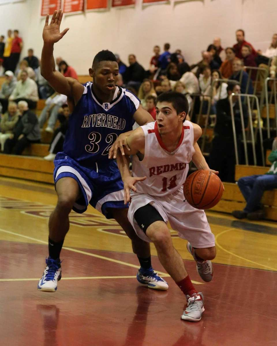 East Islip's Mike Simonetti #12 drives toward the