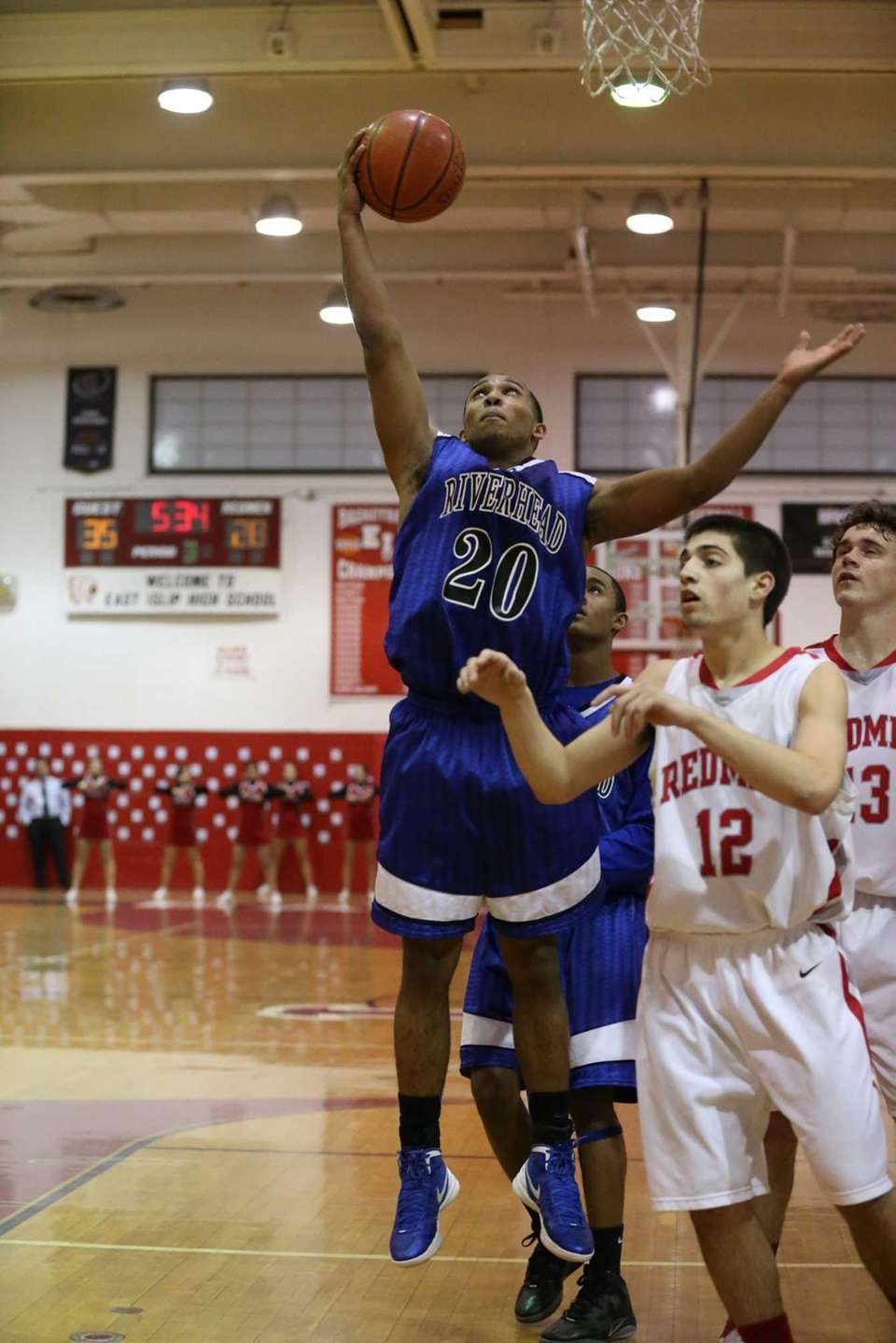 Riverhead's Jeremiah Cheatom #20 gets the rebound over