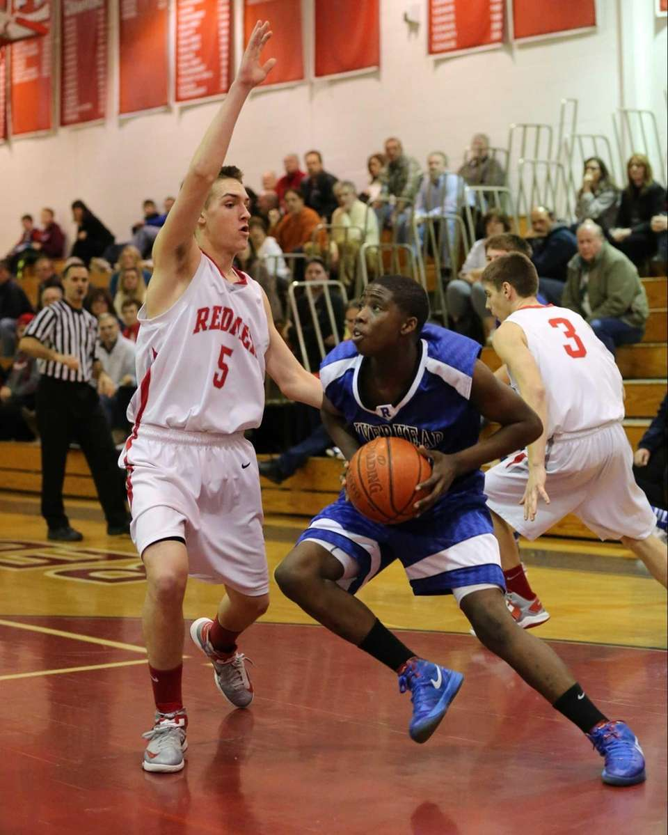 Riverhead's Markim Austin #23 drives toward the net