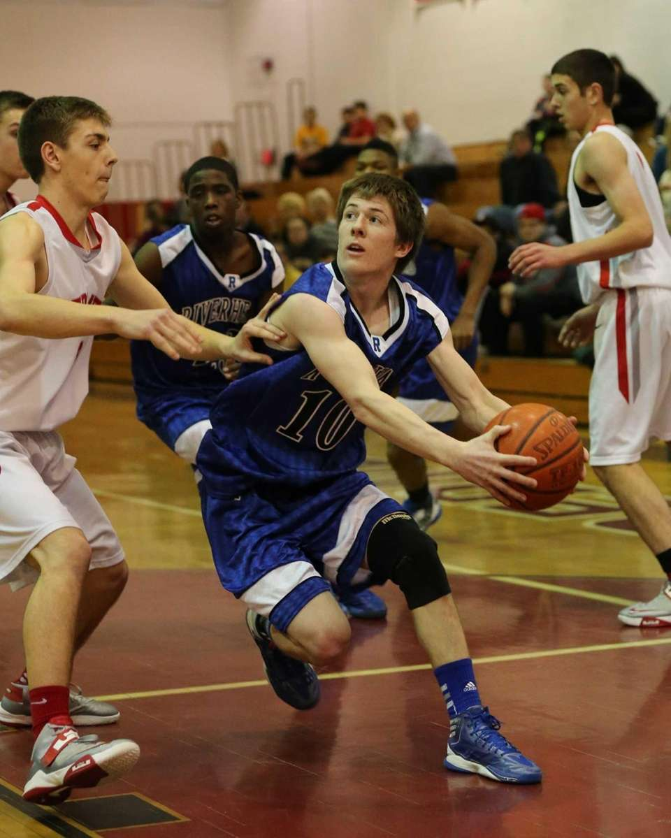 Riverhead's Ryan Bitzer #10 drives to the net