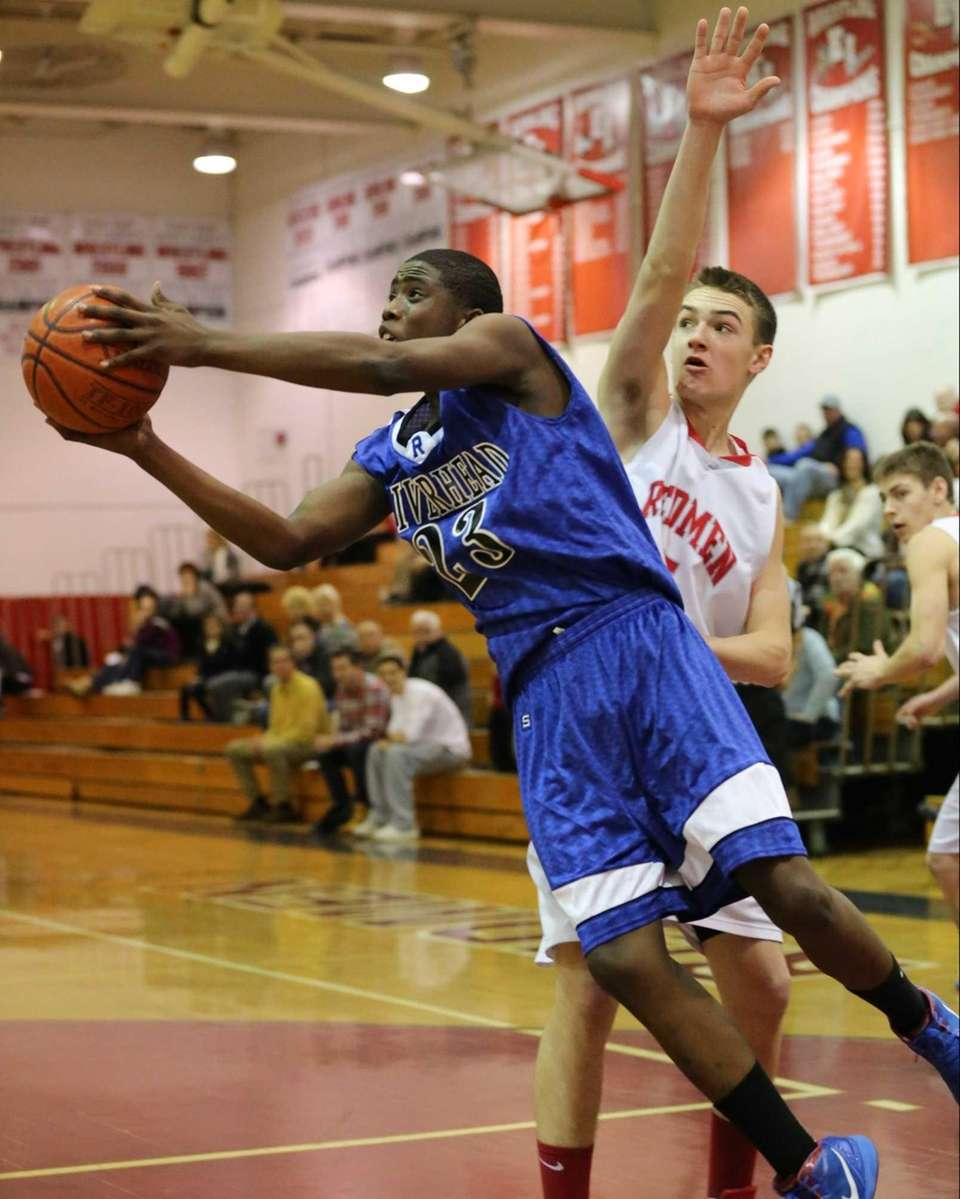 Riverhead's Markim Austin #23 goes for a shot