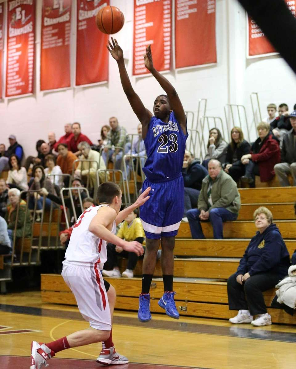 Riverhead's Markim Austin #23 sinks a three-pointer over