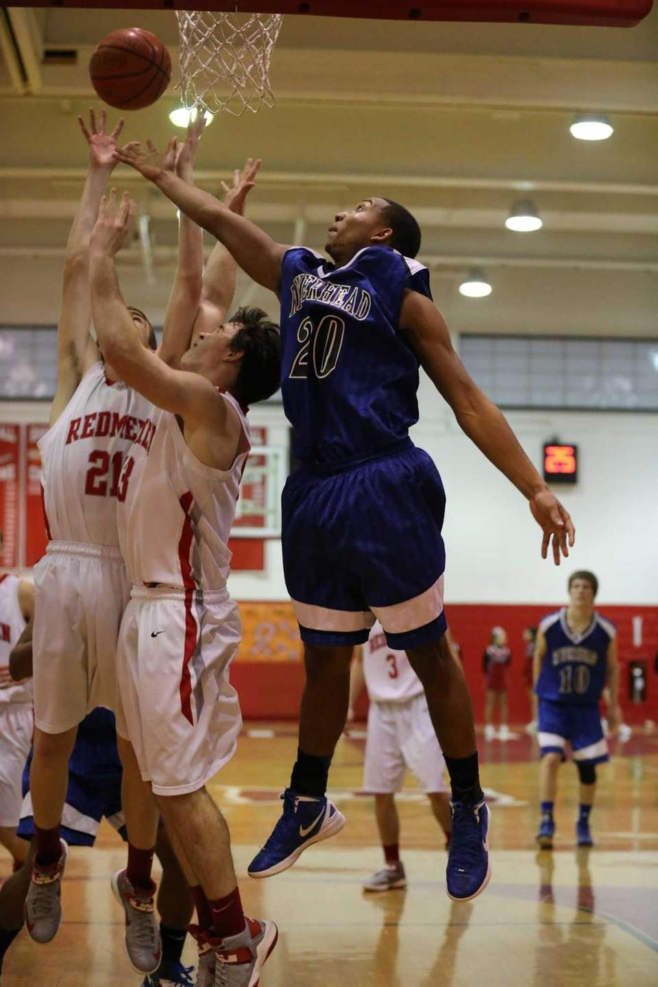 Riverhead's Jeremiah Cheatom #20 fights for the rebound