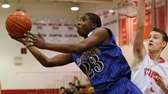 Riverhead's Markim Austin #23 goes for the layup