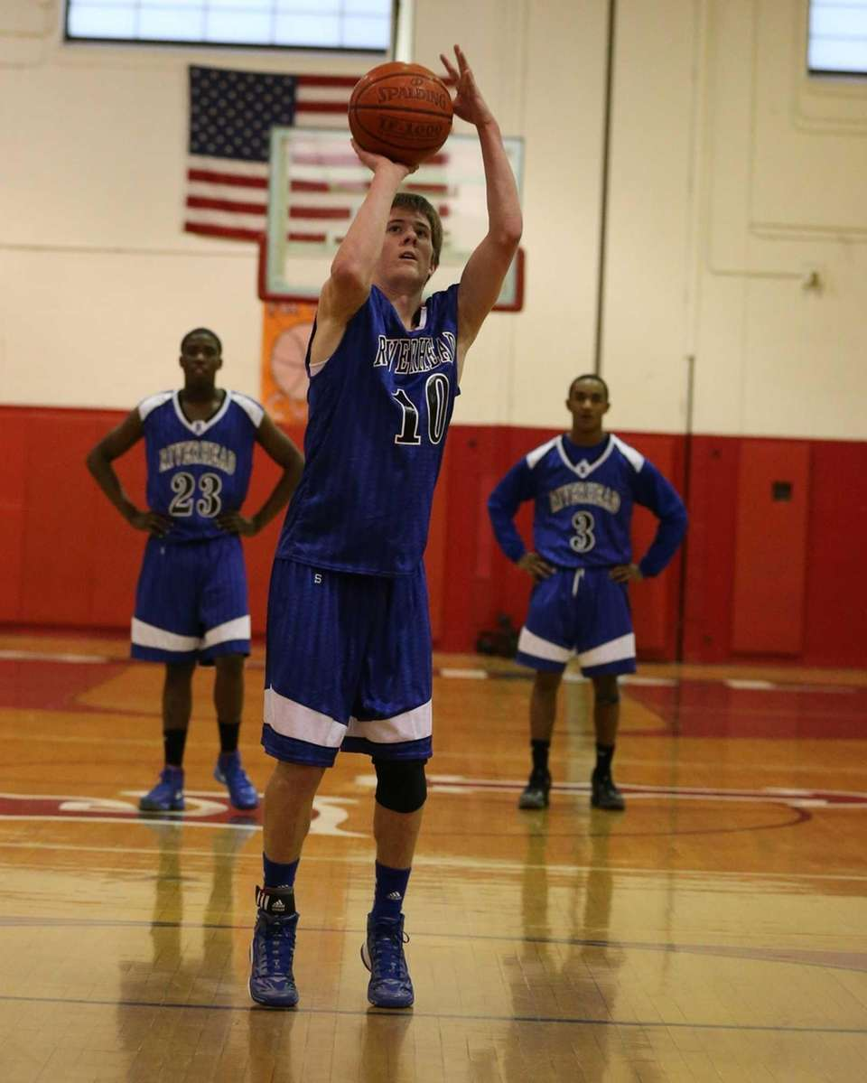 Riverhead's Ryan Bitzer #10 sinks a foul shot