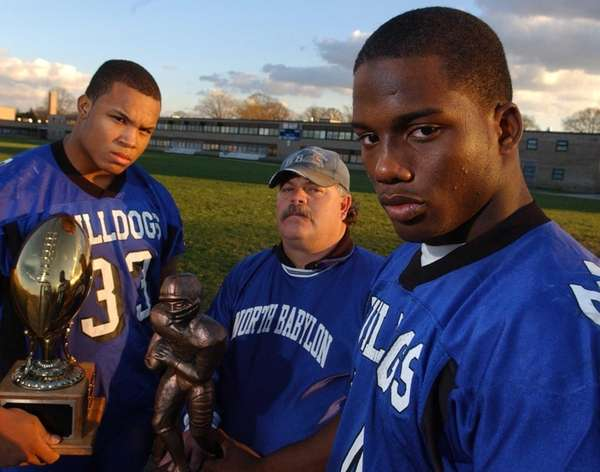 North Babylon football star, Jason Gwaltney, right, poses