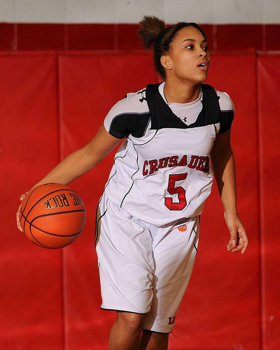 Long Island Lutheran's Kaela Hilaire dribbles upcourt in