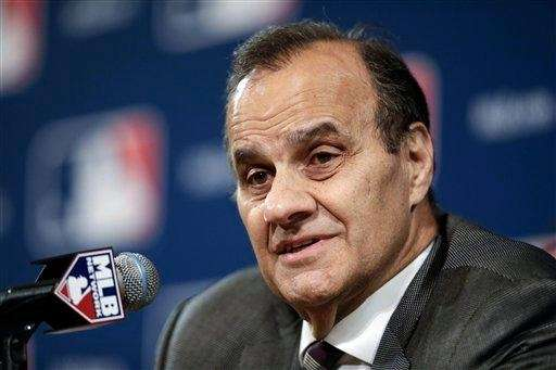 Joe Torre answers questions at the baseball winter