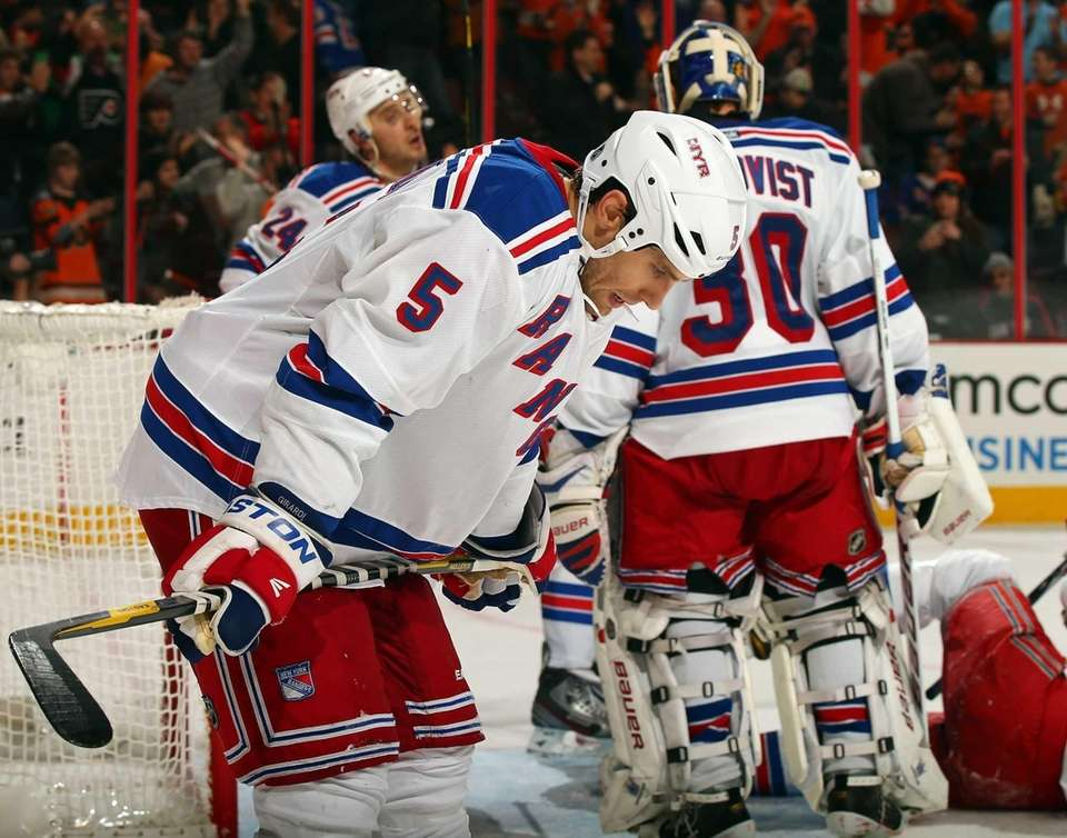 Dan Girardi reacts after Jakub Voracek of the