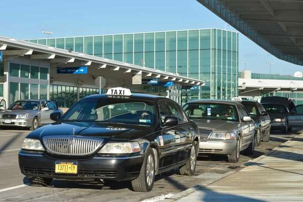 A line of taxis wait for customers at