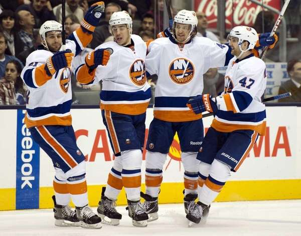 From left, Frans Nielsen, Travis Hamonic, Michael Grabner