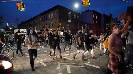 Protesters walk from Barclays Center along DeKalb Avenue