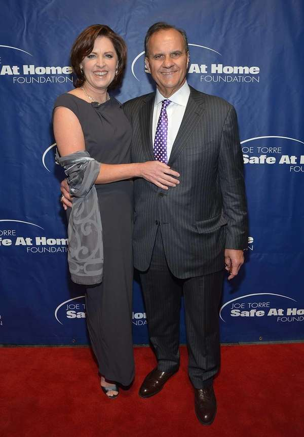 Alice Wolterman, left, and Joe Torre attend his